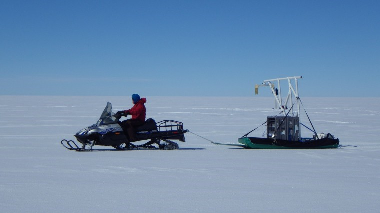Dartmouth field team member, Alden Adolph, conducting a radar survey at Summit Camp in Greenland with the CReSIS surface-based Snow Radar System. (Photo courtesy of Allison Morlock from Dartmouth). Source: https://dartmouthigert.wordpress.com/category/igert-fellows/alden- adolph/page/7/, post by Alden Adolph on June 27, 2013)